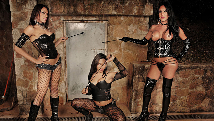 3 Strong Ladyboys In Black Latex and Leather Gangbanging His Male Slave